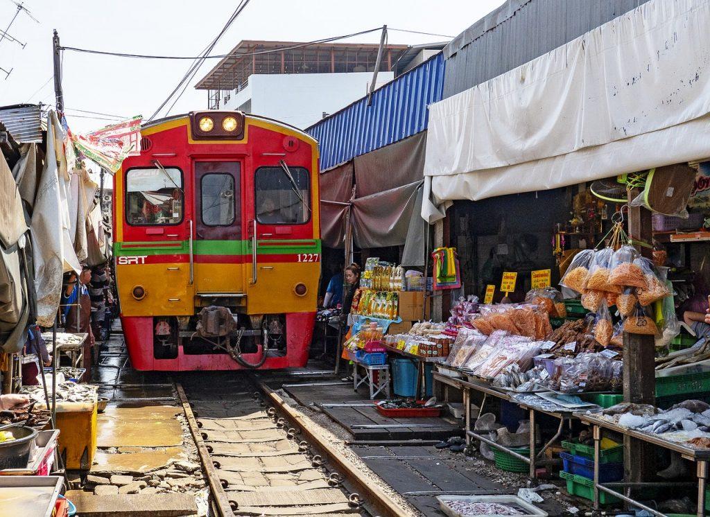 Train running through market in Bankgok