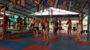 Muay Thai Students practicing elbows